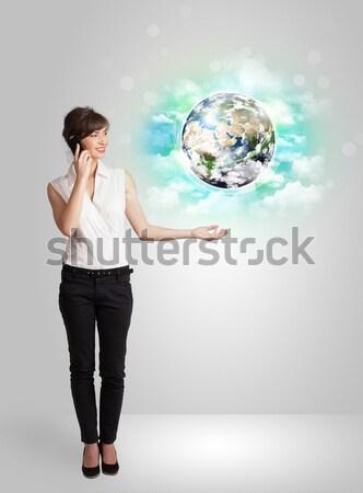 Businesswoman on rock mountain with a globe Stock photo © ra2studio