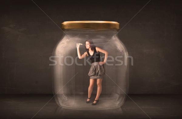 Stock photo: Businesswoman captured in a glass jar concept