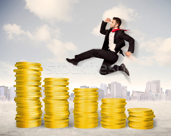 Successful business man jumping up on gold coin money Stock photo © ra2studio