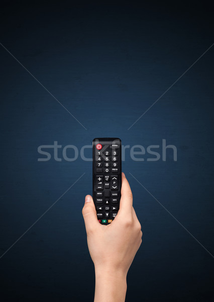 Stock photo: Hand with remote control