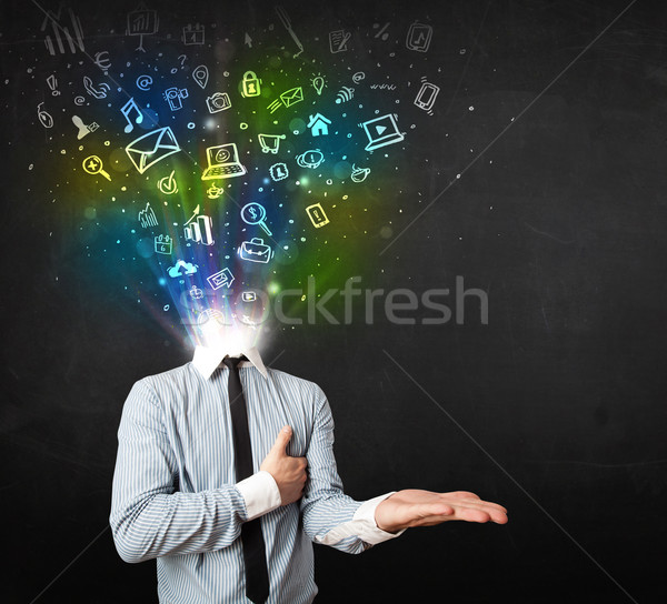 Business man with glowing media icons exploding head  Stock photo © ra2studio