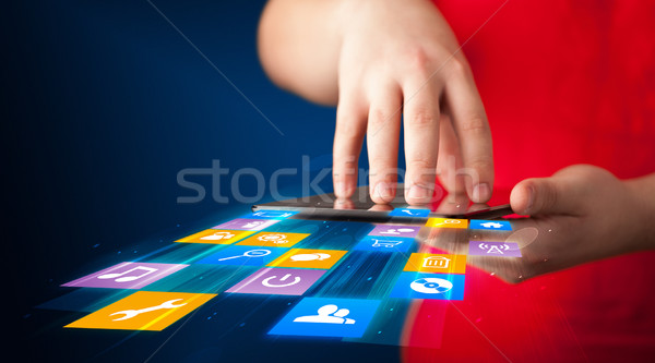 Hand holding tablet device with media application Stock photo © ra2studio