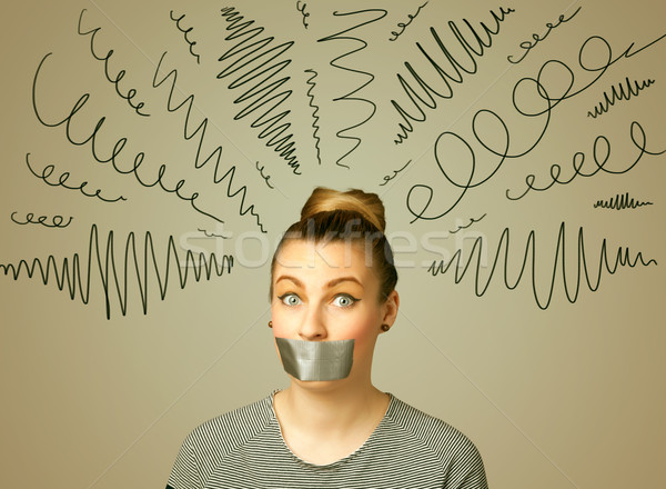 Young woman with glued mouth and curly lines Stock photo © ra2studio