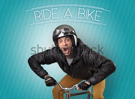 Stock photo: Nutty cyclist on his bike