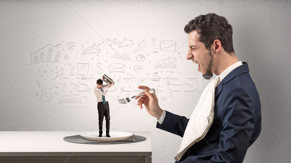 Big businessman eating small employee with doodled charts concept Stock photo © ra2studio