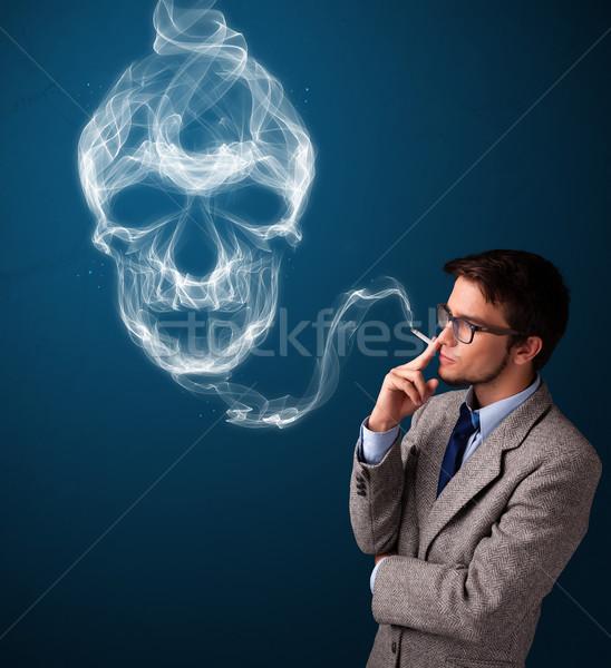 Joven fumar peligroso cigarrillo tóxico cráneo Foto stock © ra2studio