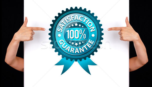 hand pointing to Satisfaction Guarantee Label  Stock photo © ra2studio