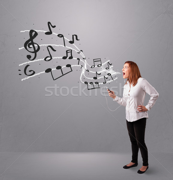 Stock photo: attractive young lady singing and listening to music with musical notes