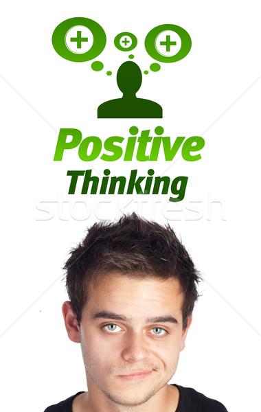 Giovani testa guardando positivo negative segni Foto d'archivio © ra2studio