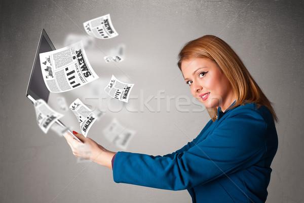 Joli jeune femme portable lecture explosive Photo stock © ra2studio