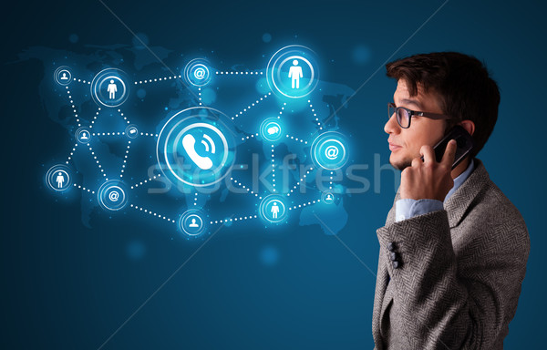 Young boy making phone call with social network icons Stock photo © ra2studio