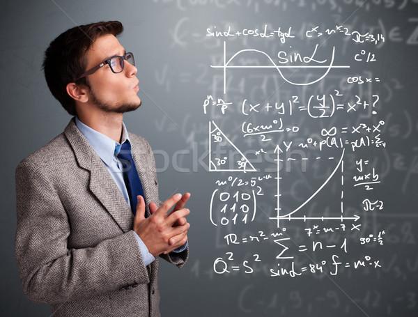 Guapo pensando complejo matemático signos Foto stock © ra2studio