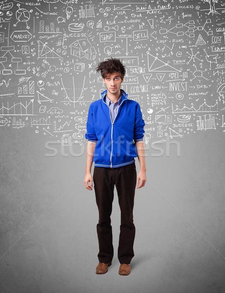 Young handsome guy with hand drawn calculations and icons Stock photo © ra2studio