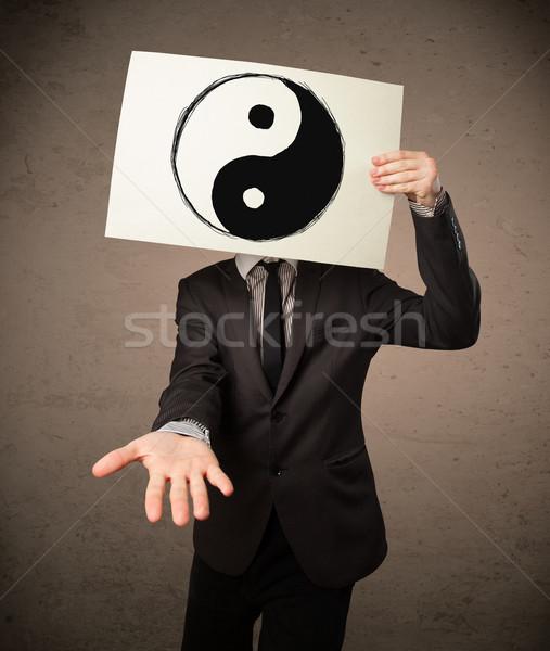 üzletember tart papír szimbólum kéz férfi Stock fotó © ra2studio