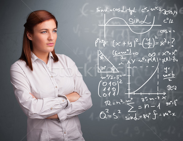 Mooie schoolmeisje denken complex wiskundig borden Stockfoto © ra2studio