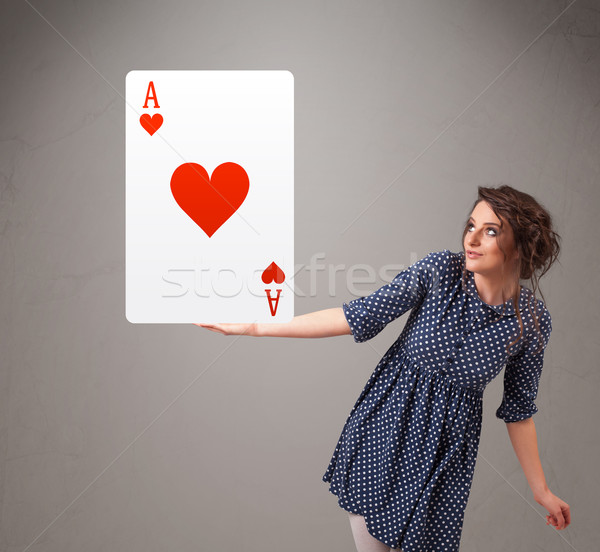 Beautifu woman holding a red heart ace Stock photo © ra2studio