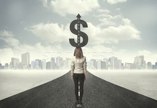 Business woman on road heading toward a dollar sign Stock photo © ra2studio