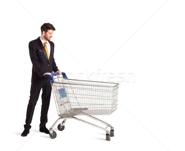 Biznesmen koszyk popychanie odizolowany garnitur sklep Zdjęcia stock © ra2studio
