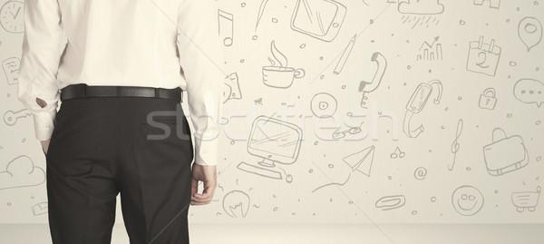 Businessman with social media icons Stock photo © ra2studio