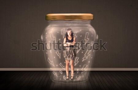 Femme d'affaires à l'intérieur verre jar foudre dessins Photo stock © ra2studio