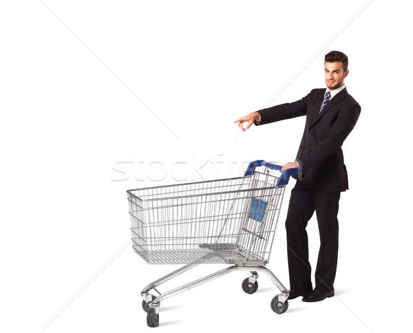 Businessman with shopping cart Stock photo © ra2studio