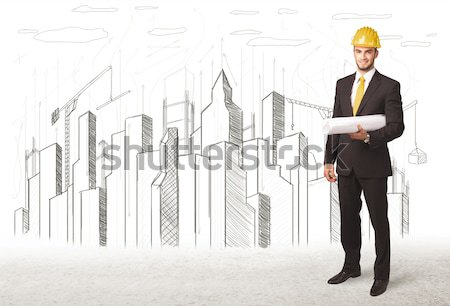 Engineer man with building city drawing in background Stock photo © ra2studio