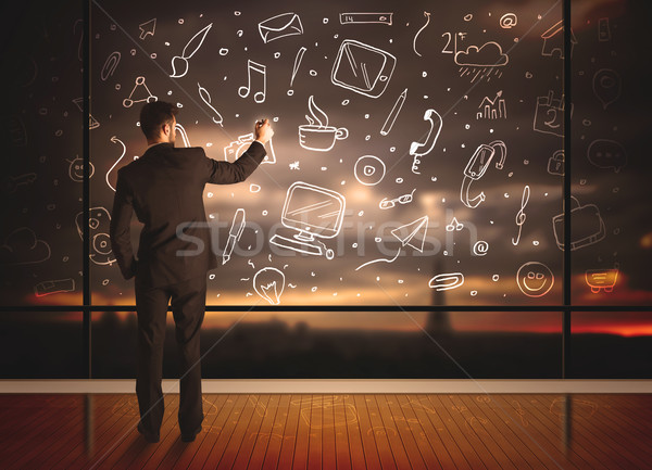 Drawing businessman with social media icon background Stock photo © ra2studio
