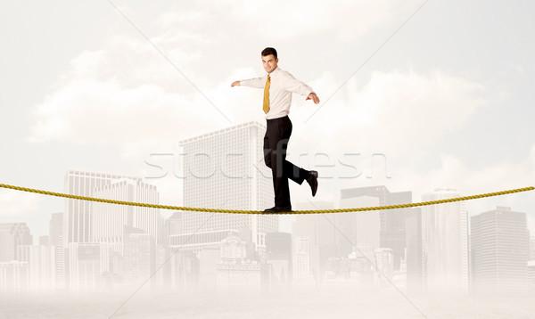 Empresário equilíbrio dourado corda jovem elegante Foto stock © ra2studio