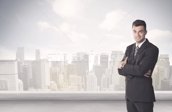 Sales person talking in front of city scape Stock photo © ra2studio