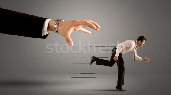 üzletember fut messze hatalmas kéz sport Stock fotó © ra2studio