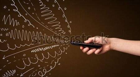 Main télécommande lignes Photo stock © ra2studio