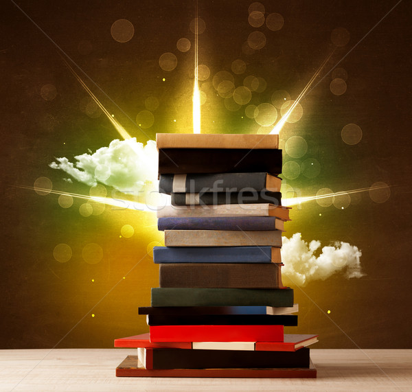 Magical books with ray of magical lights and colorful clouds Stock photo © ra2studio
