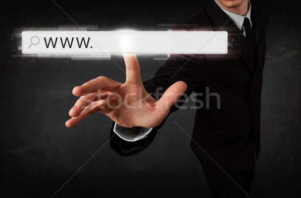 Young businessman touching web browser address bar with www sign Stock photo © ra2studio
