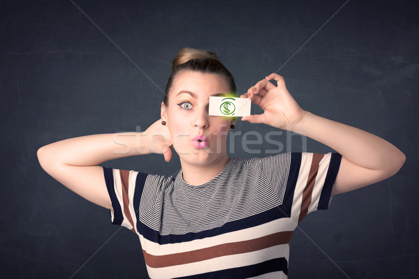Jeune fille papier vert signe du dollar affaires Photo stock © ra2studio
