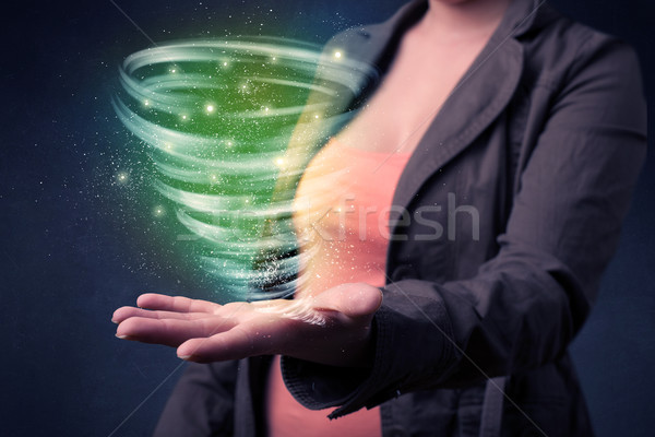 Stock photo: Woman holding green tornado
