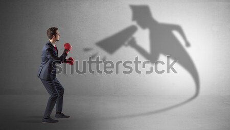 Businessman with imp shadow and toreador concept Stock photo © ra2studio