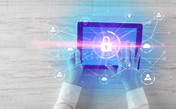 Hand using tablet with network security and online storage syste Stock photo © ra2studio