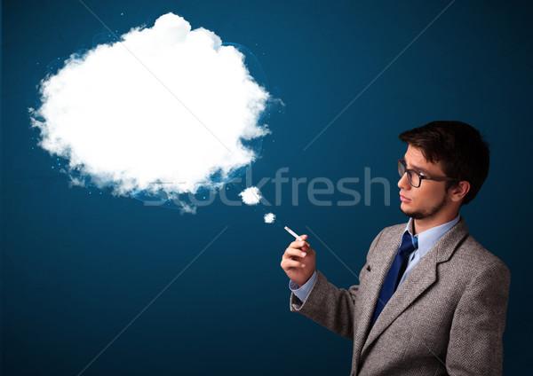 Junger Mann Rauchen ungesund Zigarette Rauch Stock foto © ra2studio