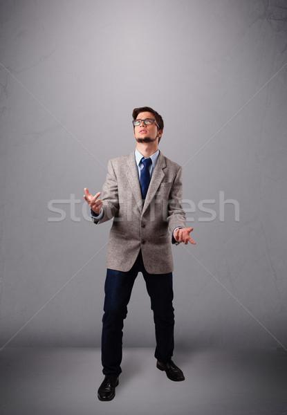 Grappig man jongleren exemplaar ruimte permanente hand Stockfoto © ra2studio
