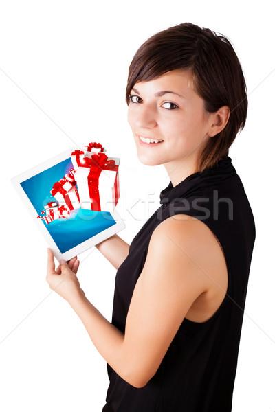 Stok fotoğraf: Genç · kadın · bakıyor · modern · tablet · sunmak · kutuları