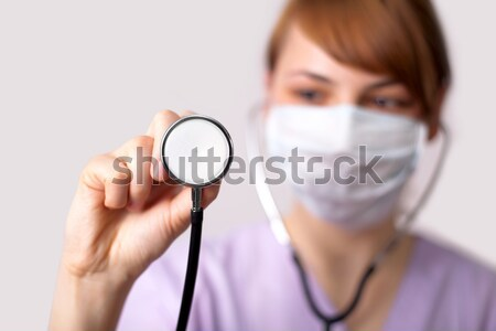 Female doctor holding stethoscope pointed toward camera 5 Stock photo © ra2studio
