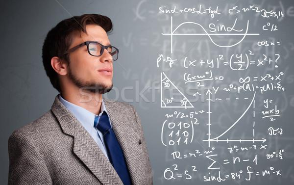 Knap schooljongen denken complex wiskundig borden Stockfoto © ra2studio