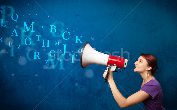 Stock photo: Young girl shouting into megaphone and text come out