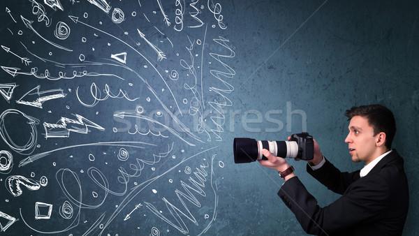 Fotograaf jongen schieten energiek Stockfoto © ra2studio