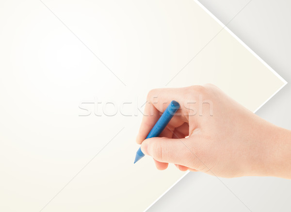 Child drawing with colorful crayon on empty blank paper Stock photo © ra2studio