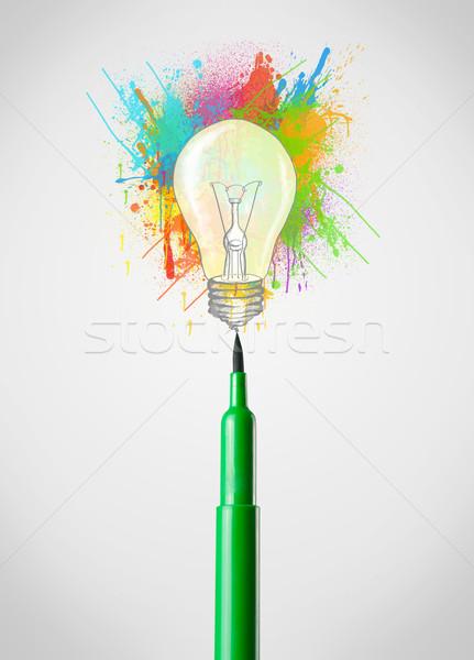 Felt pen close-up with colored paint splashes and lightbulb Stock photo © ra2studio