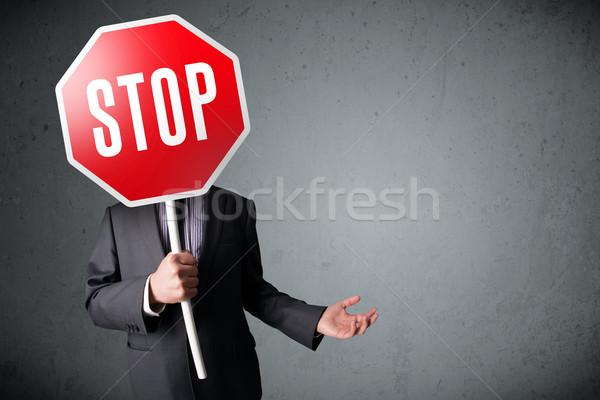 Empresário sinal de parada em pé cabeça mão Foto stock © ra2studio