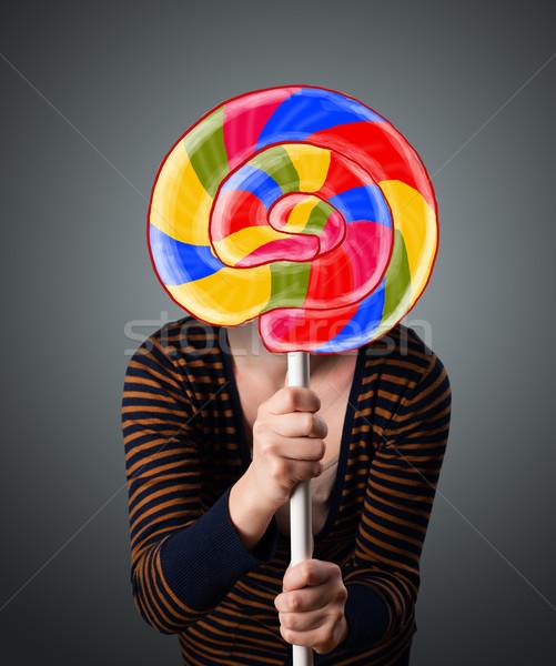 Młoda kobieta lizak młodych pani kolorowy Zdjęcia stock © ra2studio