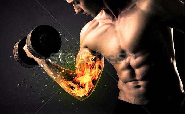 Vücut geliştirmeci atlet ağırlık yangın kol Stok fotoğraf © ra2studio