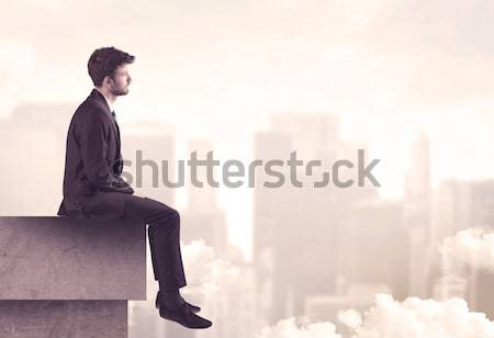 Peaceful sales guy sitting on roof top Stock photo © ra2studio